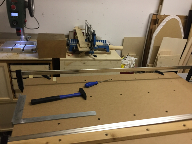 The holes for the clamping grid.